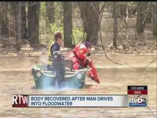 Searchers find body of man washed away by flooding