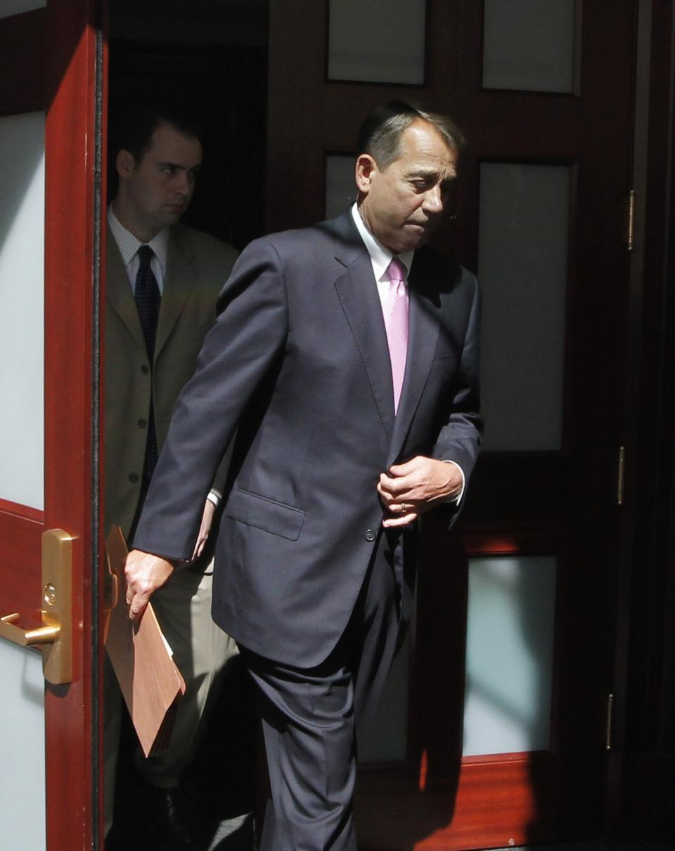 House Speaker  John Boehner of Ohio emerges from a closed-door caucus with House Republicans as work continues to avert a default, Wednesday, July 27, 2011, on Capitol Hill in Washington.  (AP Photo/J. Scott Applewhite)