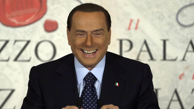 "FILE - In this Dec. 12, 2012 file photo Silvio Berlusconi smiles as he speaks during a book presentation of Italian journalist Bruno Vespa ""Il Palazzo e la Piazza"" (The Palace and the Square) in Rome. Former Premier Silvio Berlusconi announced a deal Monday with the Northern League, his fractious coalition partner in three governments, to jointly run in Italy's election next month. The move could give fresh impetus to the center-right and extend the Berlusconi era. While leaving open the question of whether he will run himself, Berlusconi underlined his ambitions for the deal reached overnight at his villa near Milan by saying: ""Habemus Papum,"", the Latin phrase for ""We have a pope."" (AP Photo/Gregorio Borgia, File)"