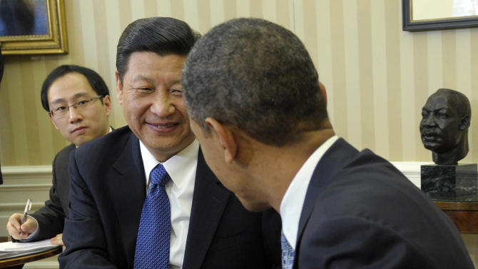 FILE – In this Feb. 14, 2012, file photo President Barack Obama and Chinese Vice President Xi Jinping, left, shake hands as they engage with media during their Oval Office meeting at the White House in Washington. When Obama and Jinping meet again at week's end for an unusual two-day summit at a Southern California estate, Obama will be looking for signs of seriousness in China's recent private pledges to address cyberhacking, which he has said is a rapidly growing threat to U.S. national security. This while keeping present that it is China, whose help will be needed to stem nuclear threats from North Korea and Iran, to curtail the violence in Syria, and to build on the U.S. economic recovery. (AP Photo/Susan Walsh, File)