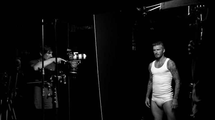 "This image released by H&M shows soccer star David Beckham, right, during a photo shoot to promote his latest underwear line at H&M. Beckham says he's in the underwear game for the long haul, looking forward to advancing his bodywear partnership with H&M. The soccer star's second set of ads for his branded collection launch Thursday. They'll coincide with a ""statue stunt"" planned by the retailer with larger-than-life Beckhams going up in New York, Los Angeles and San Francisco. (AP Photo/H&M)"