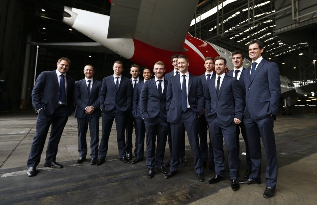 Australia cricket players pose for team photos under a Qantas A380 aircraft during the official team farewell at Sydney airport