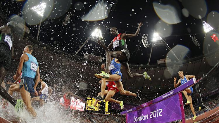 FILE - In this Sunday, Aug. 5, 2012 file photo taken with a fisheye lens, Kenya's Ezekiel Kemboi clears the obstacle in the men's 3000-meter steeplechase final during the athletics in the Olympic Stadium at the 2012 Summer Olympics, in London. (AP Photo/Matt Dunham, File)