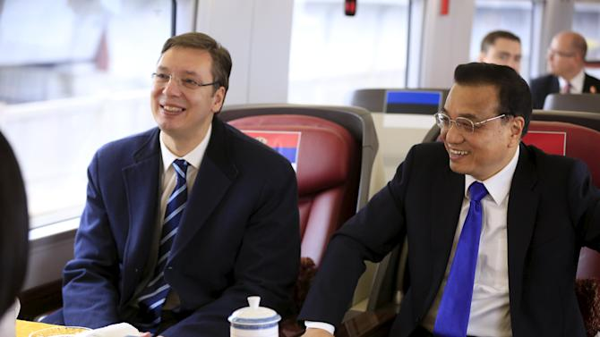 China's Premier Li and Serbia's PPM Vucic sit on a CRH Harmony bullet train to Shanghai from Suzhou Railway Station after the 4th Meeting of Heads of Government of China and Central and Eastern European Countries, near Shanghai, China