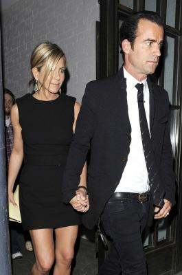 Jennifer Aniston and Justin Theroux are spotted leaving Shoreditch House walking hand-in-hand in London on July 20, 2011 -- Pacific Coast News