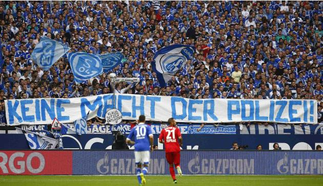 Supporters of Schalke 04 hold up a banner during their German first division Bundesliga soccer match against Bayer Leverkusen in Gelsenkirchen