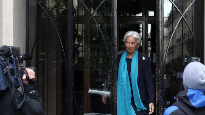 IMF Managing Director Christine Lagarde, leaves her apartment building before appearing in French court, in Paris, Thursday, May 23, 2013. Lagarde is being investigated by a special French court over a controversial arbitrage deal, which she oversaw as French Finance minister in 2008. (AP Photo/Thibault Camus)