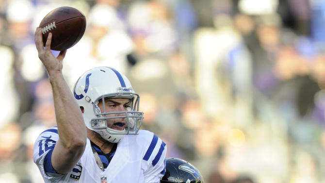 Indianapolis Colts quarterback Andrew Luck (12) is hit by Baltimore Ravens outside linebacker Terrell Suggs (55), as he throws, during the second half of an NFL wild card playoff football game Sunday, Jan. 6, 2013, in Baltimore. (AP Photo/Nick Wass)