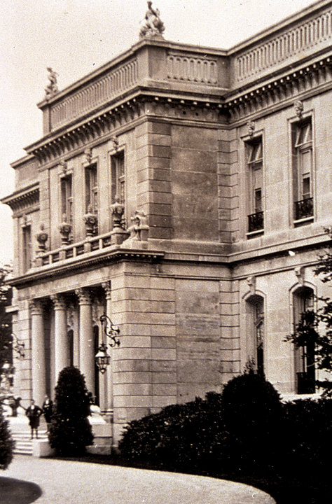 This circa 1920s photo provided by The Preservation Society of Newport County shows footmen on the front stairs of The Elms, a mansion in Newport, R.I.  Newly discovered photographs, documents and fam