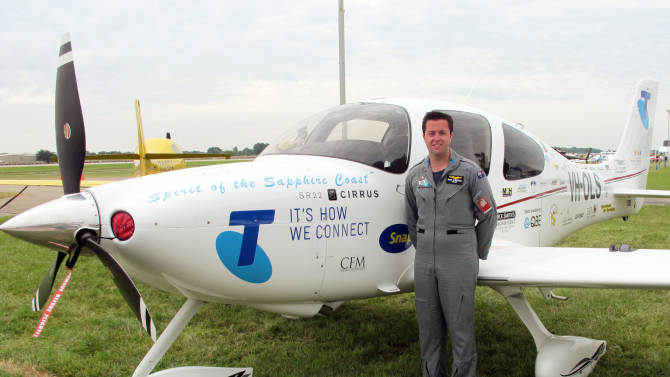 In this July 30, 2013, photo Ryan Campbell stands in front of the plane he's flying around the world at the Experimental Aircraft Association's annual convention, AirVenture, in Oshkosh, Wis. The 19-year-old Australian is trying to become the youngest person to go solo around the world and could break a world record set just a month ago by a 21-year-old Californian. (AP Photo/Carrie Antlfinger)
