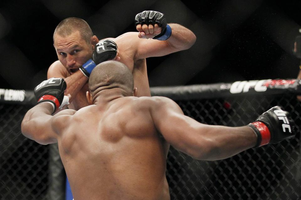 Dan Henderson defends against Rashad Evans during UFC 161 in Winnipeg, Manitoba on Saturday June 15, 2013. (AP Photo/The Canadian Press, John Woods)