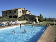 This August 2011 photo courtesy of Francesco Mattiello shows a pool and home in Tuscany where AP writer Jocelyn Noveck and some 20 others in an extended family enjoyed a two-week vacation in Italy. Renting a house is one option for a relaxing multi-generation vacation. (AP Photo/Francesco Mattiello)