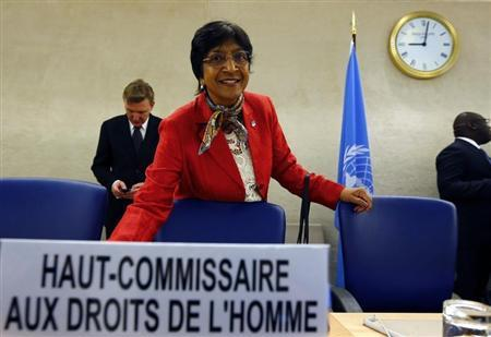 UN High Commissioner for Human Rights Pillay arrives for her address to the 25th session of the Human Rights Council at the United Nations in Geneva