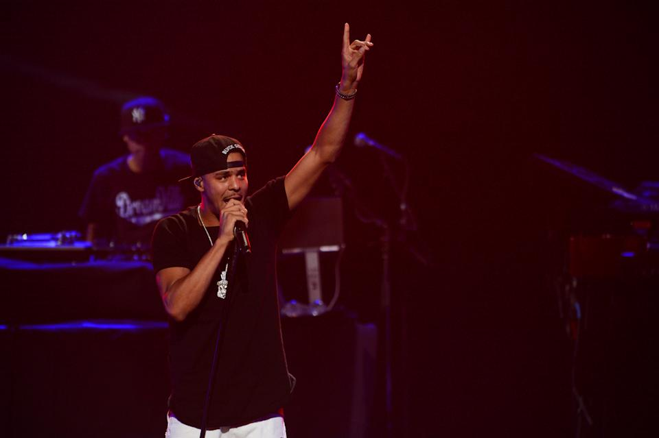 J. Cole performs at IHeartRadio Music Festival, day 1, on Friday, Sept. 20, 2013 in Las Vegas. (Photo by Al Powers/Powers Imagery/Invision/AP)