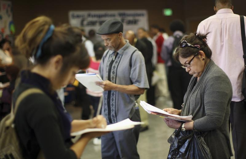 U.S. jobless rate falls to nine-year low, payrolls rise