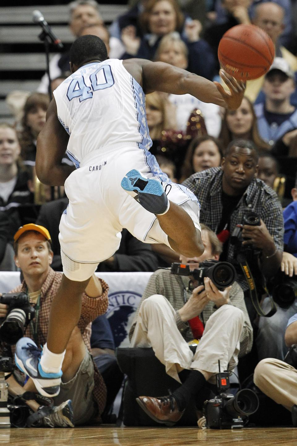 North Carolina forward Harrison Barnes (40) heads out of bounds while keeping the ball in play during the first half against Florida State in an NCAA college basketball game in the final of the Atlantic Coast Conference men's tournament, Sunday, March 11, 2012, in Atlanta. (AP Photo/John Bazemore)