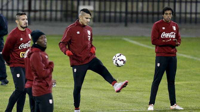 Peru's soccer team player Paolo Guerrero and other teammates attend a training session in preparation for the Copa America third place match in Concepcion, Chile