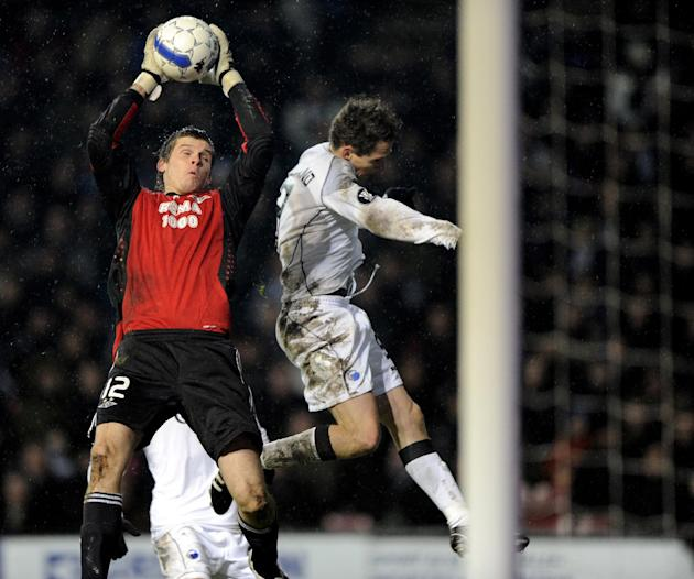 In this Dec. 4, 2008 file picture Rosenborgs goalkeeper Rune Jarstein, left, catches the ball in front of FC Copenhagens Morten Nordstrand, during the UEFA Cup group G soccer match between FC Copenhag
