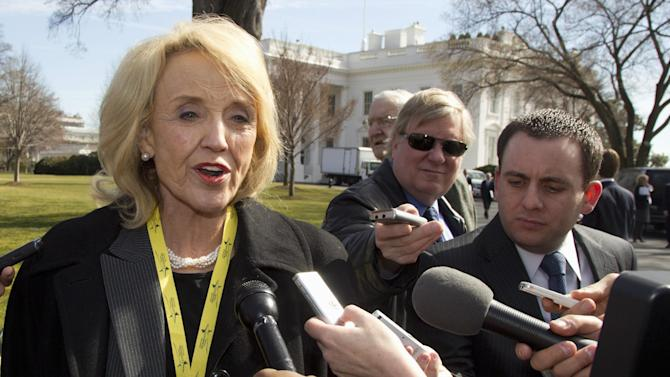 Arizona Gov. Jan Brewer talks to reporters outside the White House in Washington, Monday, Feb. 27, 2012, after she and other members of the National Governors Association attending a meeting with President Barack Obama. (AP Photo/Carolyn Kaster)