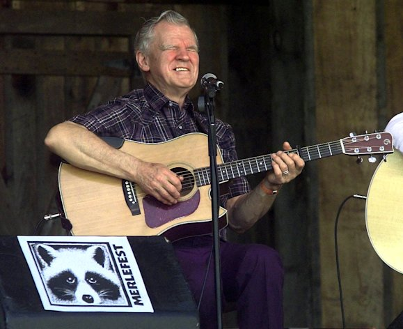 FILE - In this April 28, 2001 file photo, master flatpicker Doc Watson performs at the annual Merlefest at Wilkes Comunity College in Wilkesboro, N.C. Watson, the Grammy-award winning folk musician whose lightning-fast style of flatpicking influenced guitarists around the world for more than a half-century, died Tuesday, May 29, 2012 at a hospital in Winston-Salem, according to a hospital spokeswoman and his management company. He was 89. (AP Photo/Alan Marler, File)