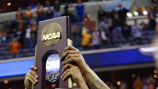 Syracuse guard Michael Carter-Williams holds up the trophy following their 55-39 win over Marquette in the East Regional final in the NCAA men's college basketball tournament, Saturday, March 30, 2013, in Washington. (AP Photo/Pablo Martinez Monsivais)
