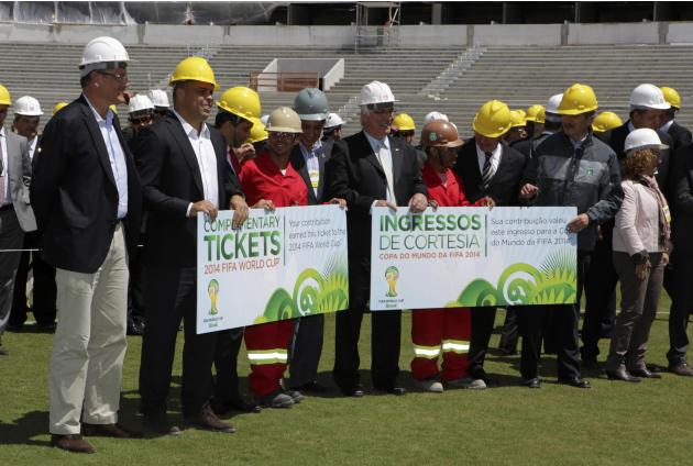 Laborers who built the Beira-Rio Stadium pose next to Brazil's Sports Minister Aldo Rebelo, FIFA Secretary General Jerome Valcke and Brazil's former national soccer player Ronaldo in Porto Alegre
