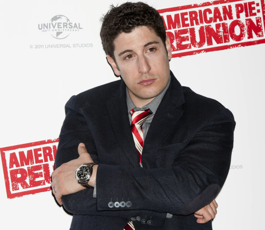 FILE - In this April 16, 2012, file photo, Jason Biggs poses for photographers in London. Biggs is getting some flak for his vulgar tweets, but the actor doesn't seem to mind. Last week, he got into some trouble for tweeting about the wives of the republican presidential candidates. (AP Photo/Jonathan Short, File)