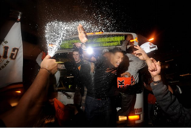 San Francisco Giants fans celebrate outside PacBell Park on Sunday, Oct. 28, 2012, in San Francisco after the Giants swept baseball's World Series against the Detroit Tigers. (AP Photo/Noah Berger