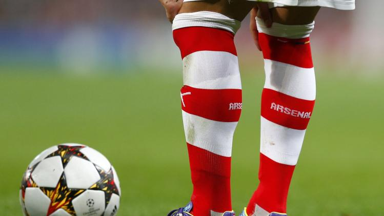 Arsenal's Santi Cazorla wears their team socks near the match ball after their Champions League playoff soccer match against Besiktas at the Emirates stadium in London