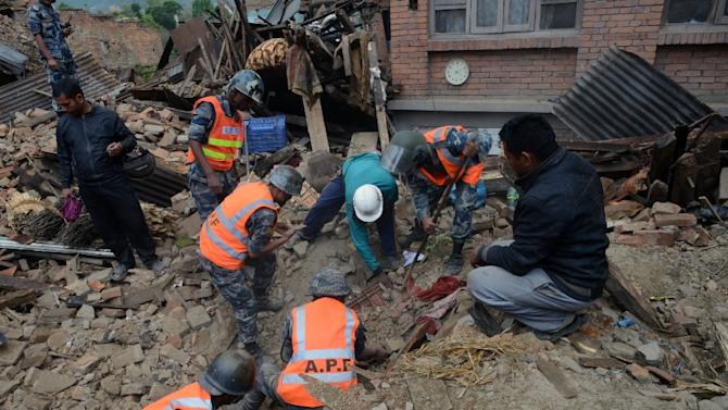 Rescuers search for survivors amidst the rubble in Bhaktapur, on the outskirts of Kathmandu, on April 27, 2015, two days after a 7.8-magnitude earthquake hit the country
