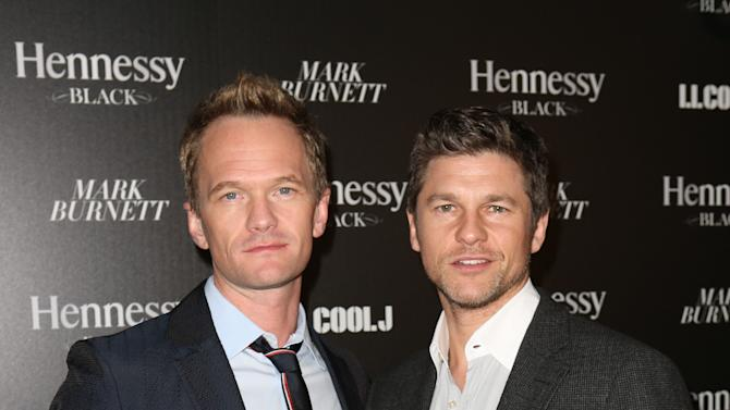 Neil Patrick Harris, left, and David Burtka attend Hennessy Black: A Dinner with LL Cool J and Mark Burnett Celebrating Music's Biggest Night Out, on Sat., Feb., 9, 2013 in Los Angeles. (Photo by Casey Rodgers/Invision for Hennessy/AP Images)