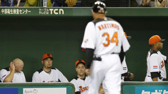 Netherlands players sit at their dugout after being beaten by Japan in their World Baseball Classic second round game at Tokyo Dome in Tokyo, Sunday, March 10, 2013. The game was called in the bottom of the seventh inning with a score of 16-4. (AP Photo/Koji Sasahara)