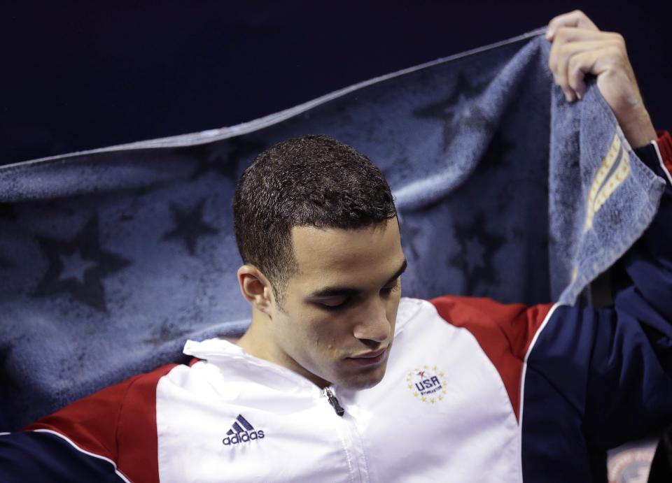 Danell Leyva rests on the bench while waiting his turn on the rings during the final round of the men's Olympic gymnastics trials, Saturday, June 30, 2012, in San Jose, Calif. (AP Photo/Gregory Bull)