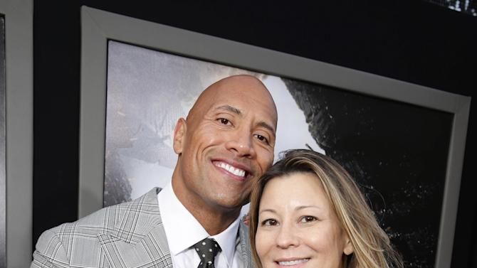 "Dwayne Johnson and Veronika Kwan Vandenberg, President of Distribution at Warner Bros Pictures International, seen at New Line Cinema presents the Los Angeles World Premiere of ""San Andreas"" at TCL Chinese Theatre on Tuesday, May 26, 2015, in Hollywood, CA. (Photo by Eric Charbonneau/Invision for Warner Bros./AP Images)"