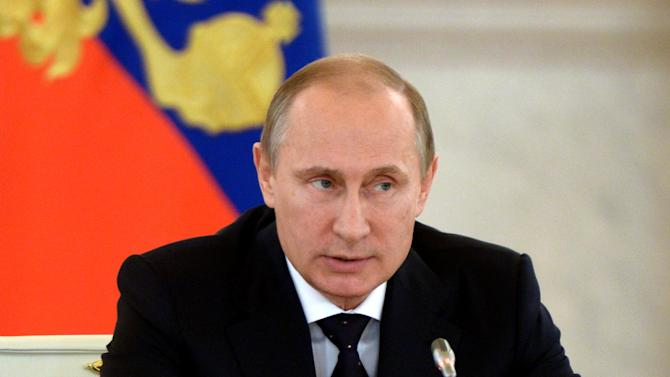 Russia's President Vladimir Putin chairs a meeting in the Kremlin in Moscow, on July 3, 2014