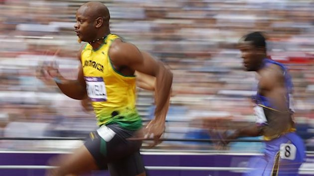 Asafa Powell of Jamaica runs on his way to winning his 100m heat round 1 during the London 2012 Olympic Games at the Olympic Stadium August 4, 2012. (Reuters)