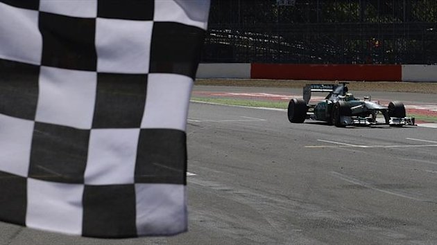 Mercedes Formula One driver Nico Rosberg (R) of Germany take the chequered flag to win the British Grand Prix at the Silverstone (Reuters)