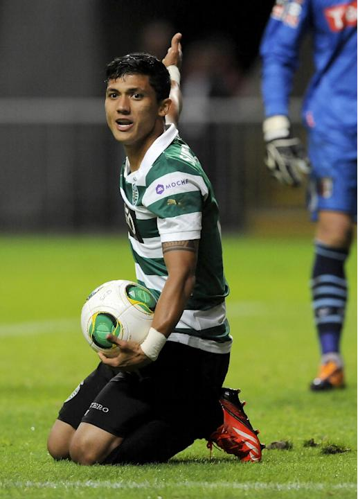 Sporting's Fredy Montero, from Colombia, gestures while holding the ball during the team's Portuguese League soccer match against Sporting Braga at the Municipal Stadium, in Braga, Portugal, Saturday