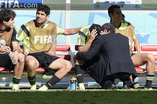 Spain's forward David Villa is comforted by Diego Costa after he was substituted during the match between Australia and Spain at the Baixada Arena in ...