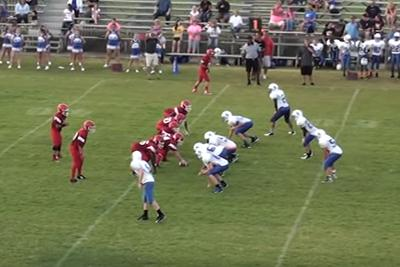 Middle school QB does ninja cartwheel to avoid sack, throws touchdown bomb