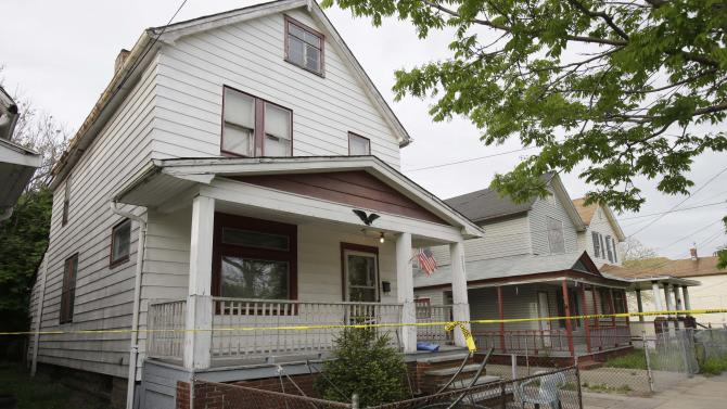A house where three women escaped is shown Tuesday, May 7, 2013, in Cleveland. Amanda Berry, Gina DeJesus and Michelle Knight, who went missing separately about a decade ago, were found Monday in the home just south of downtown Cleveland and likely had been tied up during years of captivity, said police, who arrested three brothers. (AP Photo/Tony Dejak)