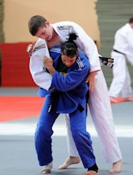 Cuban judoka Onix Cortes Aldama, selected in the women's -70 kg category for the 2012 London Olympic Games, fights with a French judoka of a local team, at a training camp in Wasquehal, northern France