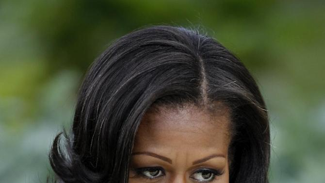 First lady Michelle Obama is interviewed by The Associated Press about the White House Kitchen Garden, Tuesday, June 5, 2012, on the South Lawn of the White House in Washington. (AP Photo/Charles Dharapak)