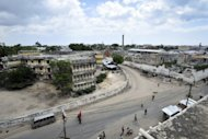 This handout photo released by the African Union-United Nations Information Support Team shows people walking in a streets of the Somali capital Mogadishu on December 8, 2012. A car bomb in Mogadishu killed three people and wounded several others in the latest attack on the war-ravaged capital, police said Friday.