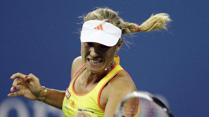 Angelique Kerber, of Germany, returns a shot to Venus Williams during a match at the U.S. Open tennis tournament, Thursday, Aug. 30, 2012, in New York. (AP Photo/Darron Cummings)