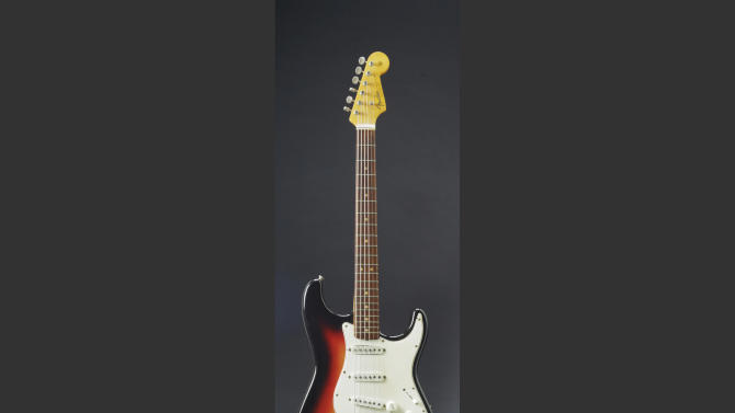 This undated photo provided by Christie's shows the Fender Stratocaster a young Bob Dylan played at the historic 1965 Newport Folk Festival. On Dec. 6, 2013, it could bring as much as half a million dollars when it comes up for auction in New York. The festival marked the first time Dylan went electric, a defining moment that marked his move from acoustic folk to electric rock and roll, drawing boos from folk-music purists. (AP Photo/Christie's)