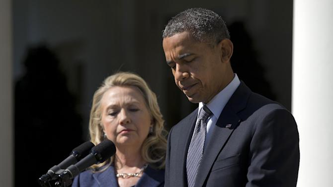 President Barack Obama, accompanied by Secretary of State Hillary Rodham Clinton, speaks about the death of U.S. ambassador to Libya Christopher Stevens, Wednesday, Sept. 12, 2012, in the Rose Garden of the White House in Washington.  (AP Photo/Evan Vucci)