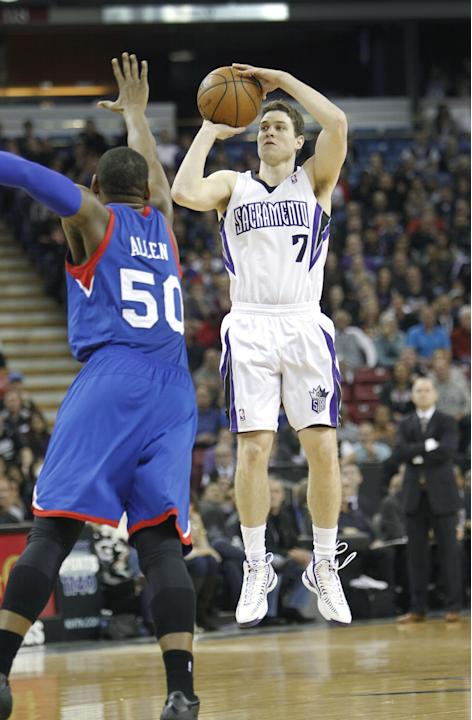Sacramento Kings guard Jimmer Fredette (7) shoots over Philadelphia 76ers defender Lavoy Allen (50) during the second half of an NBA basketball game in Sacramento, Calif., on Thursday, Jan. 2, 2014. T