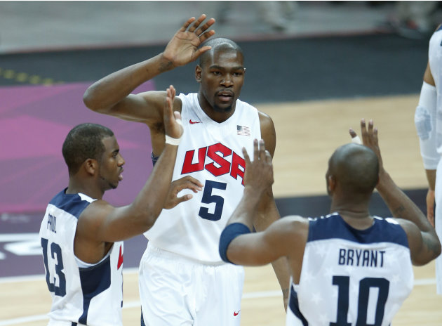 United States' Kevin Durant (5), Chris Paul (13) and Kobe Bryant (10) react during the first half of a preliminary men's basketball game against France at the 2012 Summer Olympics, Sunday, July 29, 20