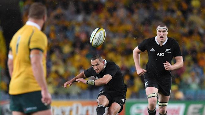 All Blacks flyhalf Aaron Cruden kicks a penalty during the rugby union Test match against the Wallabies in Sydney on August 16, 2014